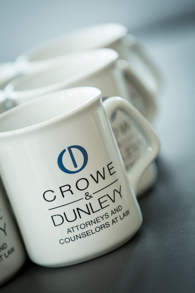 collection of coffee cups with the Crowe & Dunlevy logo